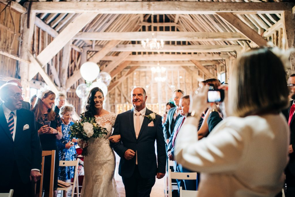 Bride and dad walk down the aisle at The Great Barn
