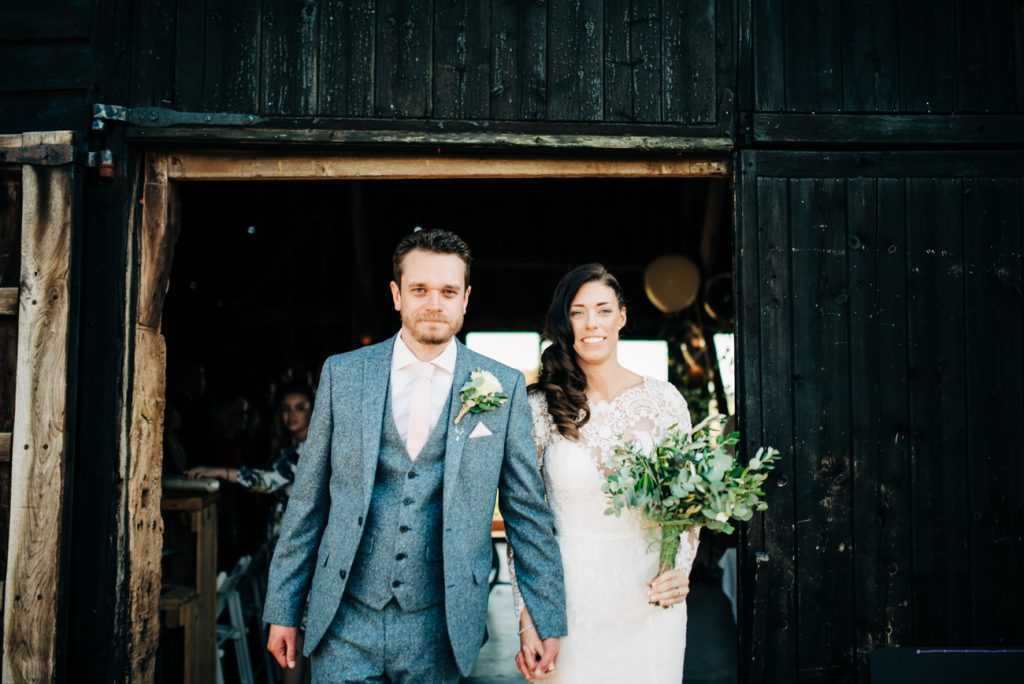 Bride and Groom exit the Great Barn in Rolvenden