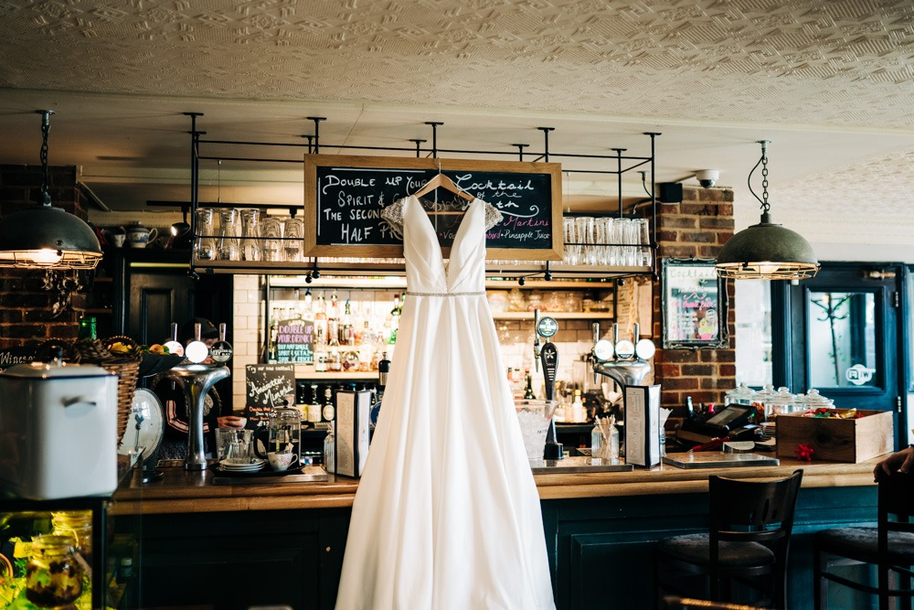 wedding dress hanging in a bar