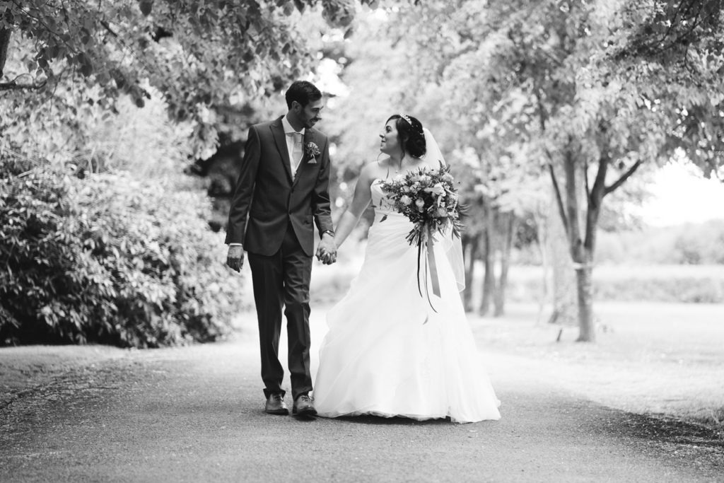 bride and groom walking at chilston park