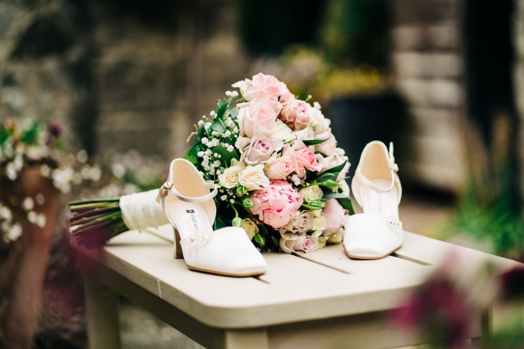brides shoes and flowers at Knowle Country House