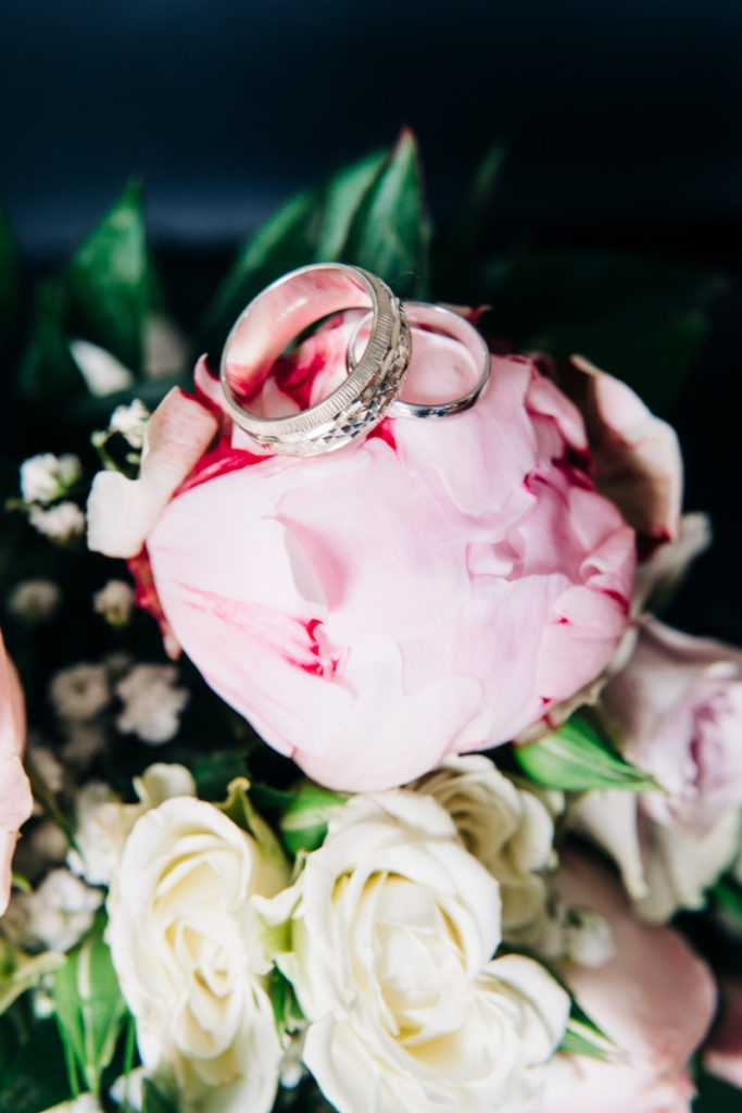 wedding rings on a peony