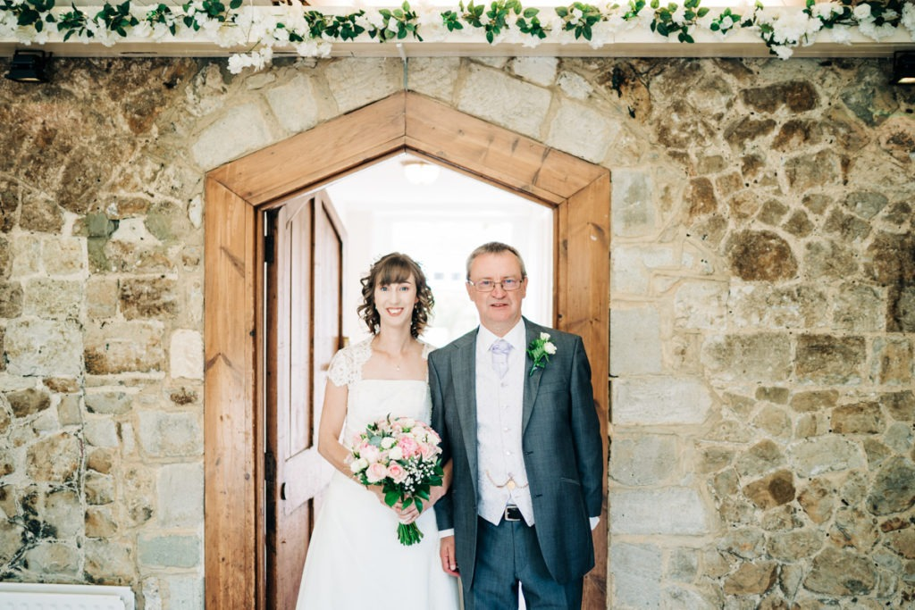 bride and dad makes entrance at Knowle Country House