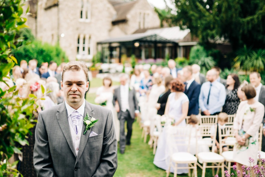 groom awaits bride arrival at Knowle Country House