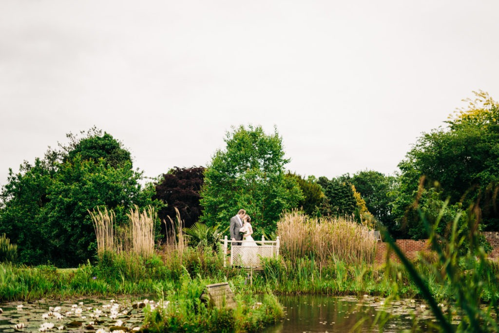bride and groom in orchards at Knowle Country House