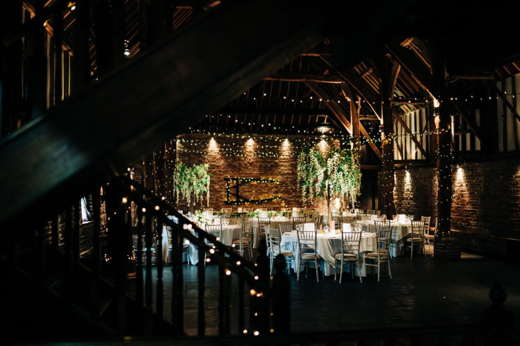 interior barn shot at cooling castle barn wedding setup