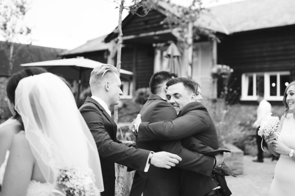 Groom hug at the Barnyard in Upchurch