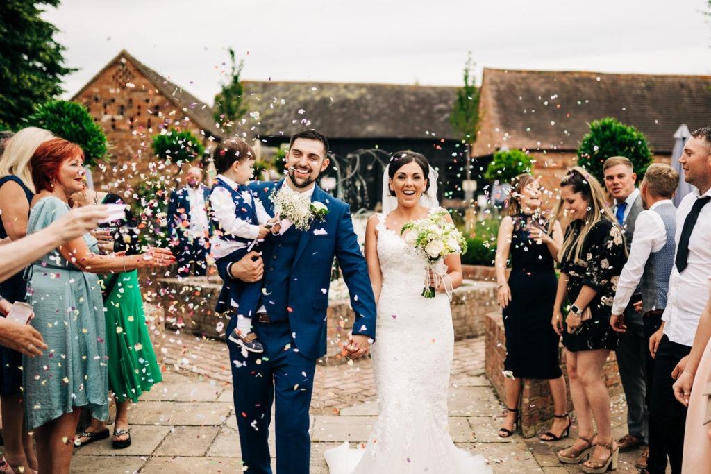 Confetti shot at twilight wedding Barnyard Upchurch