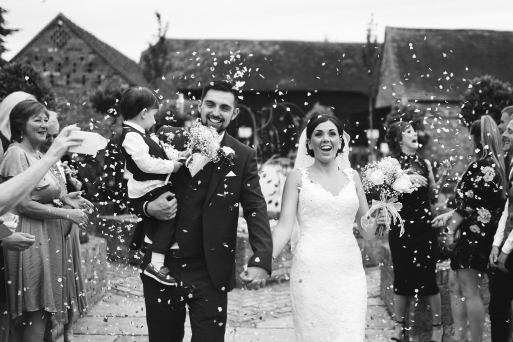 Confetti shot at twilight wedding Barnyard Upchurch