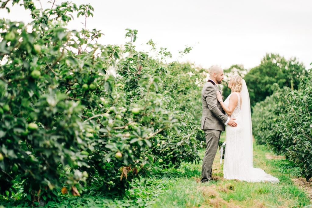 in the orchards for couples photos at Brenley Farm