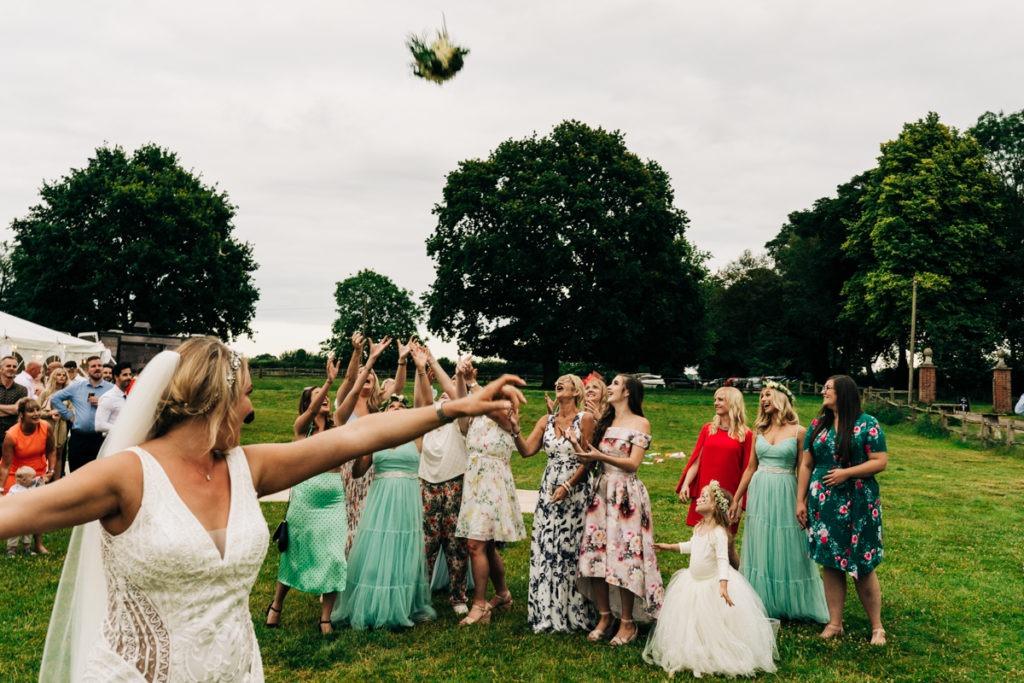 bouquet throw at Brenley Farm wedding