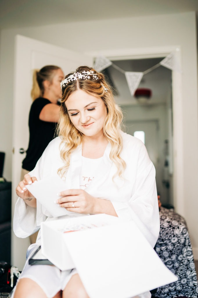 bride getting surprised from her husband to be