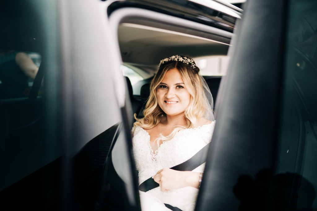 bride arrives in car at Weald of Kent