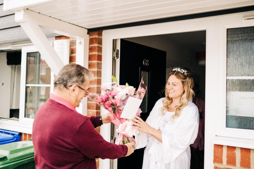bride receives flowers before wedding