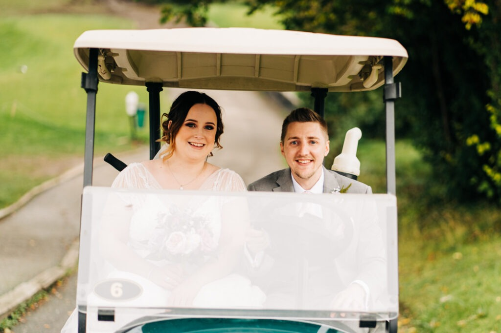 bride and groom on Golf buggy