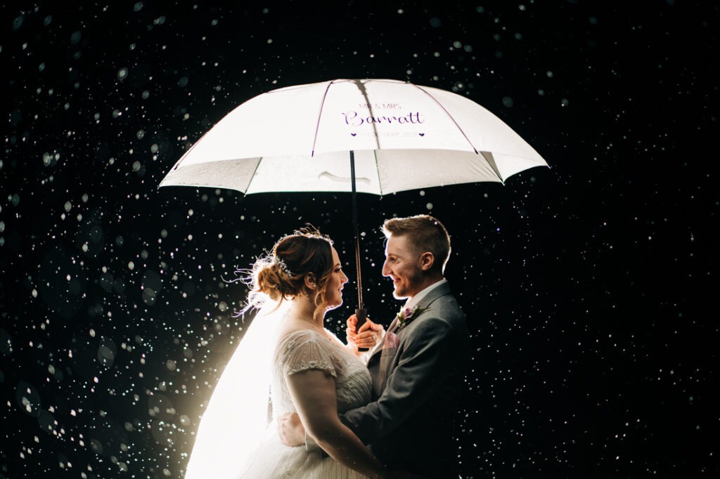bride and groom portraits in the rain