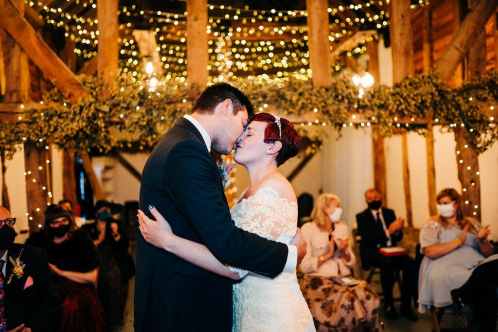 First kiss at The Barnyard Twilight Wedding